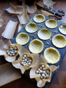 Image of tartlet cases lined with baking beans