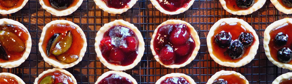 Image of jewelled berry tartlets
