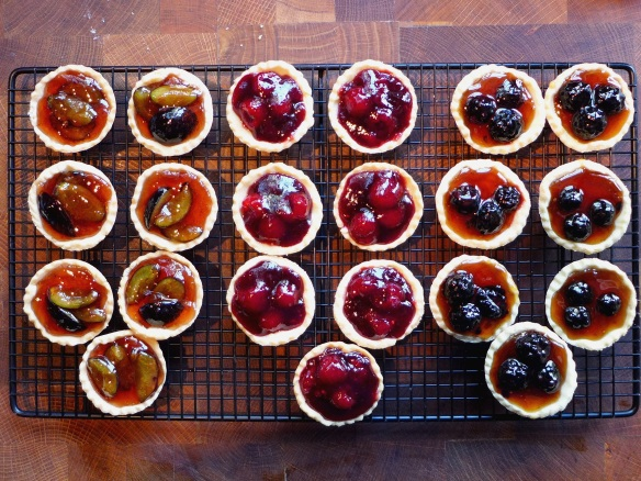 Image of jewelled berry tartlets cooling on rack
