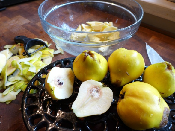 Image of quinces being peeled and sliced