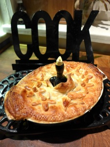 Image of pie topped with rough puff pastry