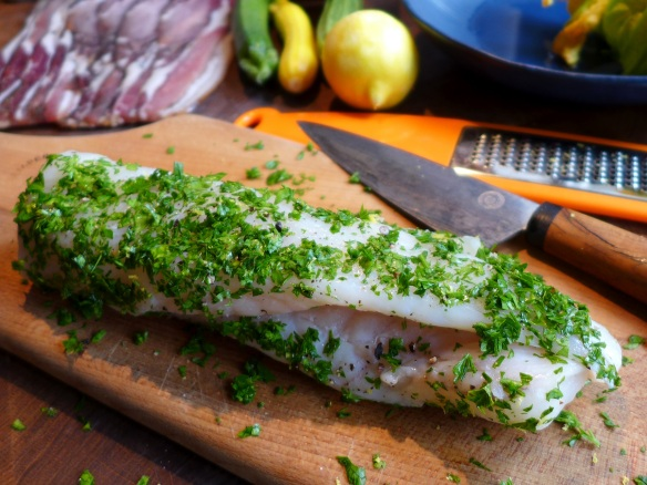 Image of fish coated with parsley and lemon zest