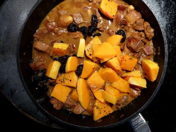 Image of prunes and squash being added