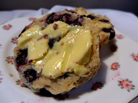 Images of scone split and buttered